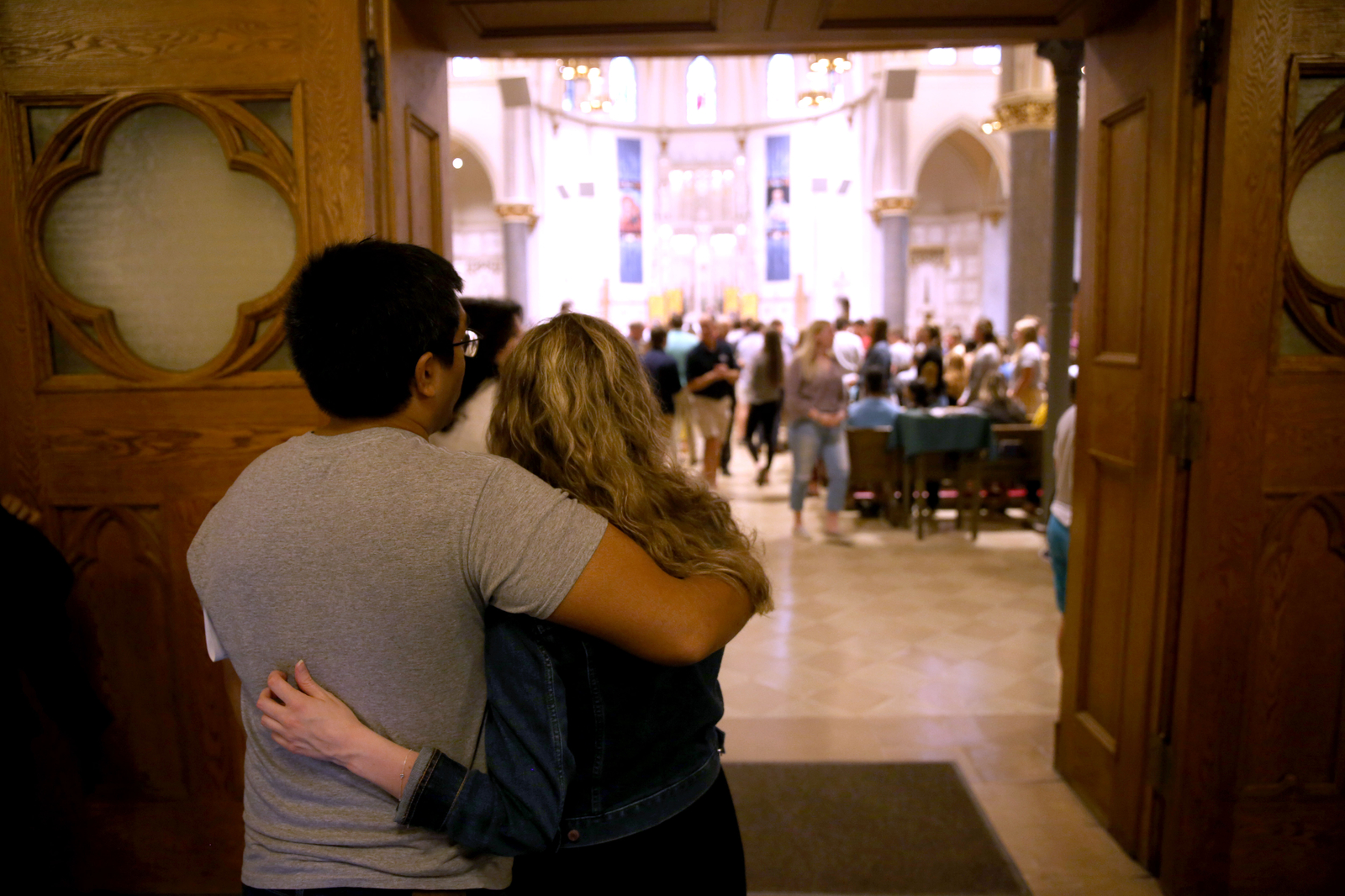 Students embracing at the Mass of the Holy Spirit