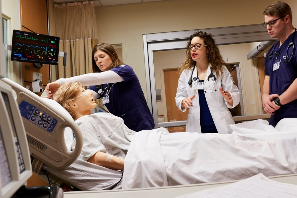 Students in Marquette's Nursing sim lab