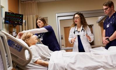 Students in Marquette's Nursing sim lab